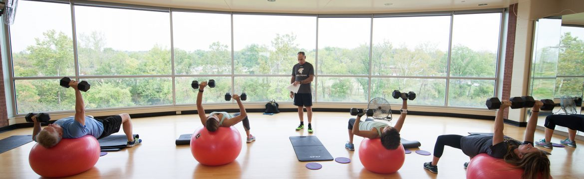 students and faculty working out during a group fitness class