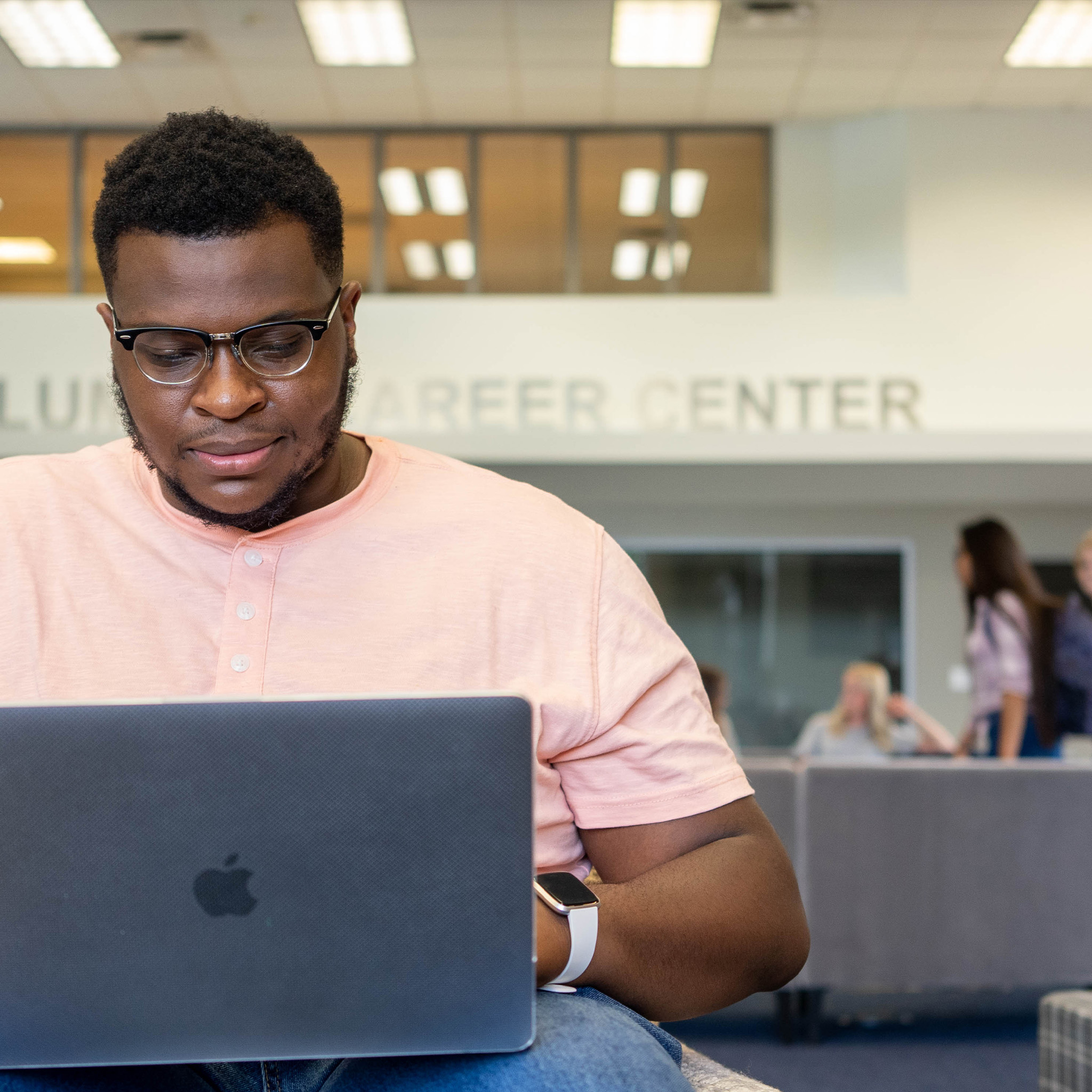 student working on computer in learning center