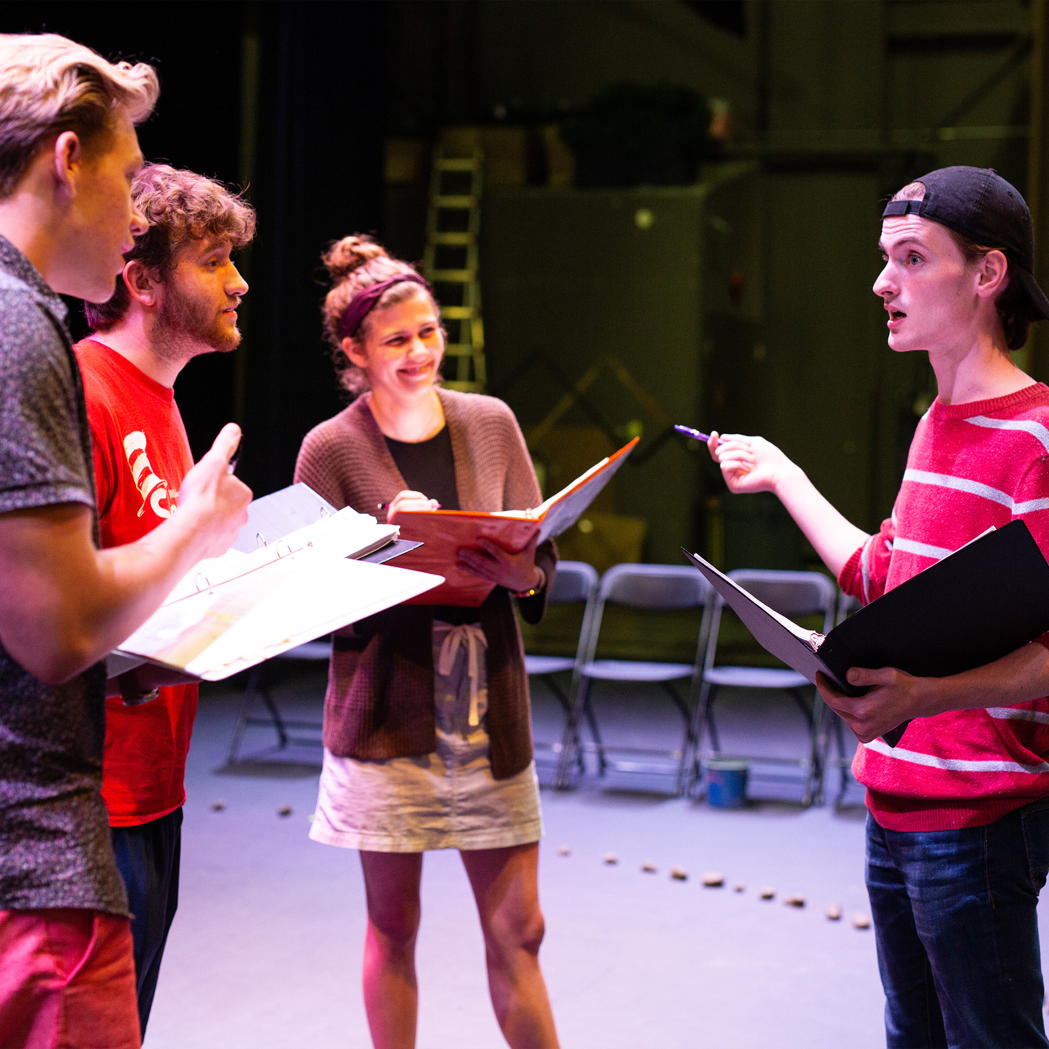 Theatre behind the scenes image, students discussing staging