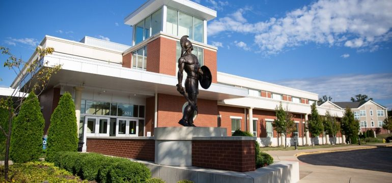Spartan Statue in front of building
