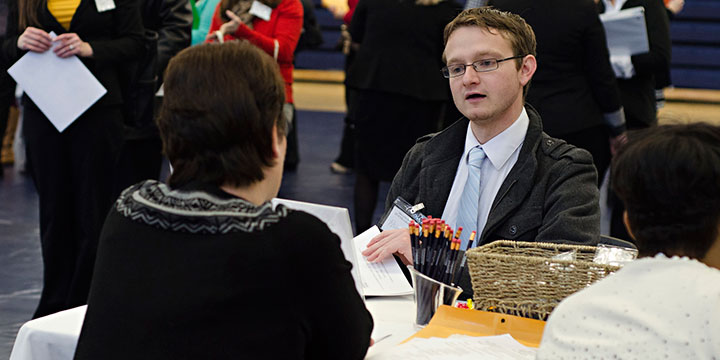 Phil Parrish, a senior English secondary education major, interviews with Rockwood School District during MBU's 2014 Education Job Fair