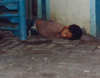 A young Soto sleeping on the streets of Tegucigalpa, Honduras.