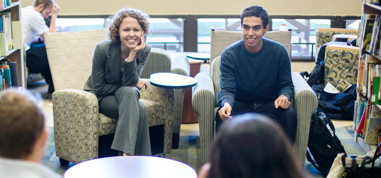 Kelly Leavitt, Instructor of English at MBU with students in the Library