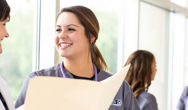 nursing student speaking with professor