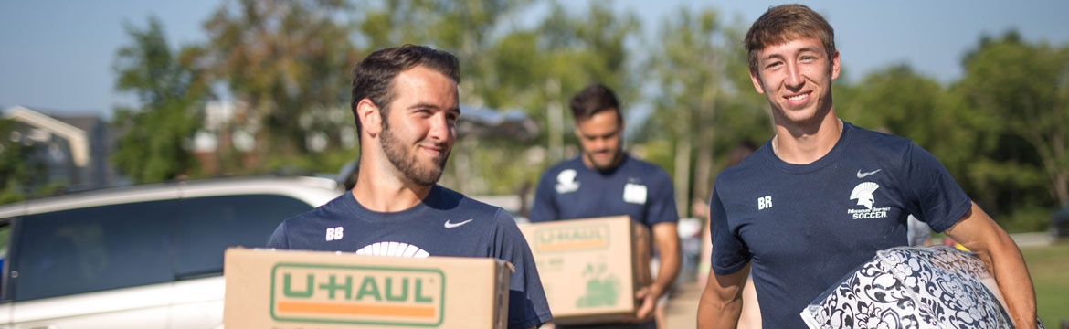 Soccer team helping with move-in day