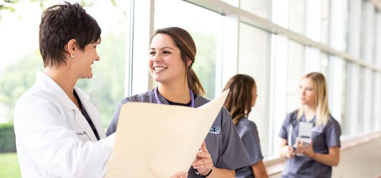 Student talking to professor in the nursing program