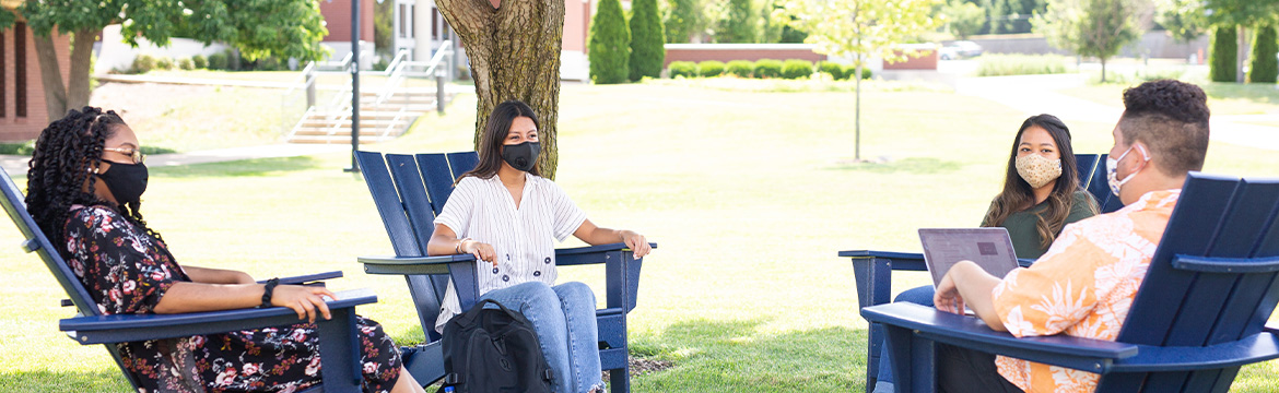 students wearing masks while sitting in the quad
